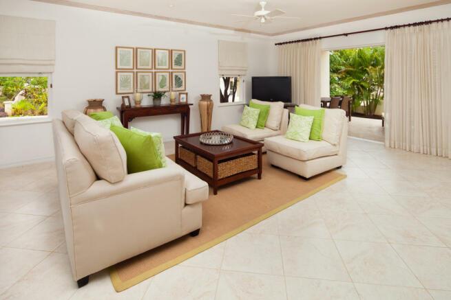 Living room sitting stone floor sliding doors Battaleys Mews St Peter Barbados