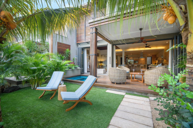 Outdoor living area of duplex home at La Balise Marina in Mauritius