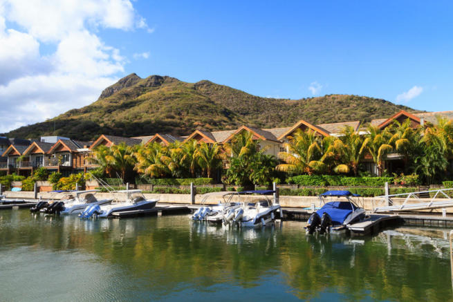 Berths outside homes at La Balise Marina in Mauritius
