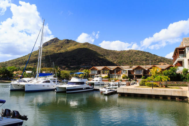 Catamaran and yacht berths with duplex apartments at La Balise Marina in Mauritius