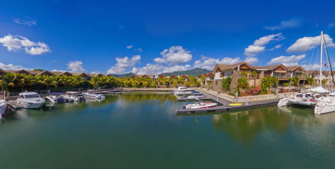 Panoramic view of marina and homes at La Balise Marina in Mauritius