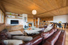 Open plan living area with fireplace at Valentine 210