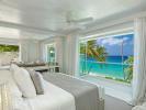 Bedroom master stone floor sliding doors ocean sea view Footprints Barbados