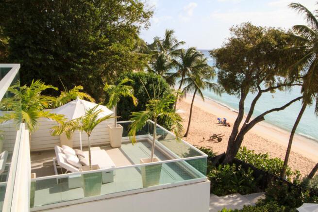 Rear view sun terrace ocean sea palm tree Footprints Barbados