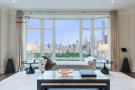Living room large window city view Central Park West New York