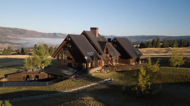 External facade of Montana ranch with misty valley
