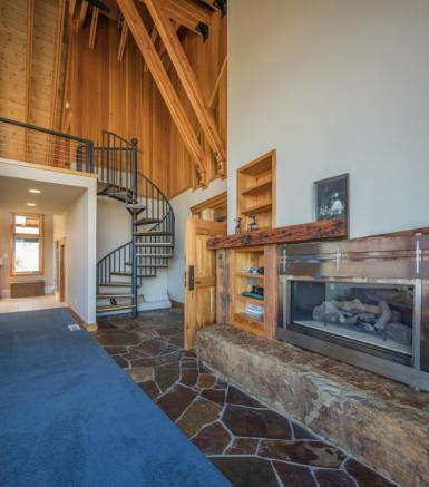 Spiral staircase and fireplace in Montana ranch