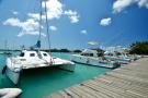 Waterman in marina near St Antoine Mauritius