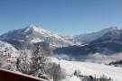 Snow covered mountain views from terrace of Chalet Alina