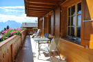 Balcony view overlooking mountains in summer at Chalet Alina