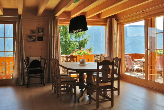 Dining room with terrace at Chalet Alina