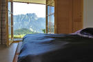 Master bedroom with mountain views at Chalet Alina