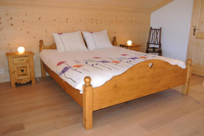 Guest double bedroom in attic at Chalet Alina