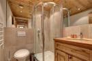 Tiled shower room at Gai Torrent apartment in Verbier
