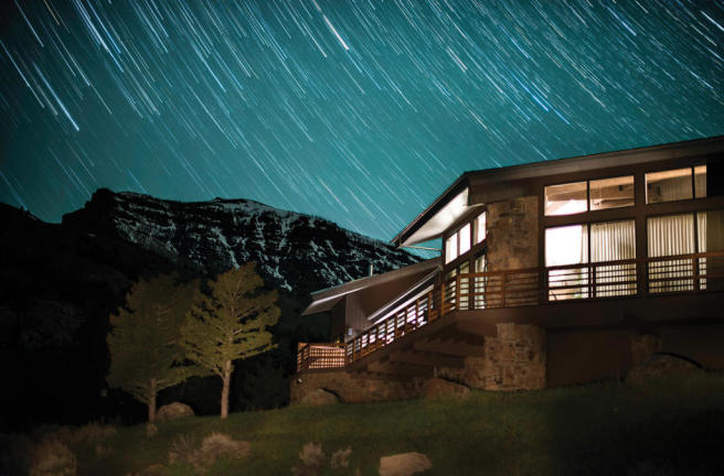 Moving stars over ranch house