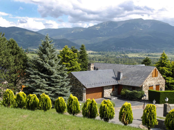 View overlooking Chalet Andorra and mountains in the summer