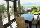 Breakfast and dining area with terrace access at Chalet Andorra