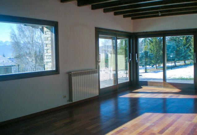 Living area overlooking garden at Chalet Andorra