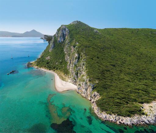 Aerial view of cliffs and Glossa Beach at Costa Navarino