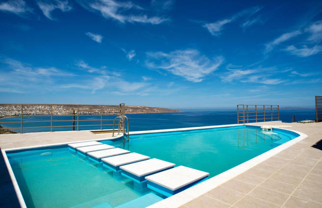 Swimming pool with kids pool area overlooking bay and sea