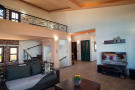 Living room with TV and mezzanine level