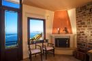 Corner fireplace and sea views