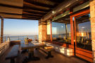 Covered terrace with outdoor dining area and sea views