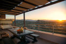 Sunset view from terrace with covered seating area