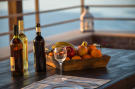 Wine and fruit on outdoor dining table
