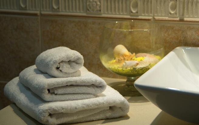 Towels and bathroom sink