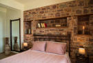 Double bedroom with stone wall