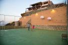 Mini basketball court and exterior facade of villa
