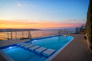 Pool area overlooking bay at dusk
