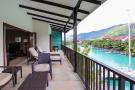 Wrap around balcony overlooking marina, yachts and hills surrounding Mahé