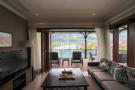 Sitting room with balcony overlooking Eden Island marina