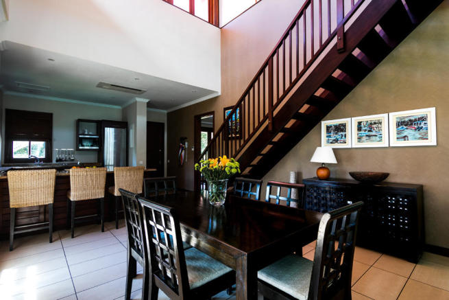 Dining and kitchen area with stairs to top floor