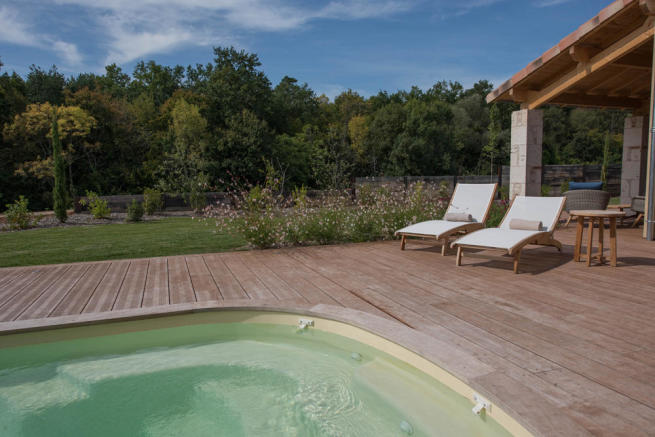 West view across Pool and wood decking
