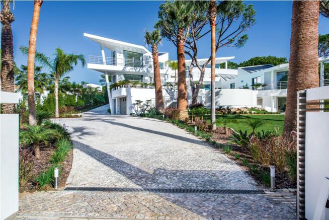 Entrance drive to modern villa