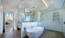 Modern bathroom with freestanding bath tub