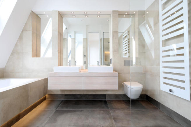 Luxury fitted bathroom with concrete effect tiles