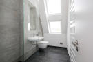 Fitted bathroom with concrete effect tiles