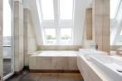 En suite bathroom with twin basins