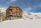 External facade of chalet apartment building in winter