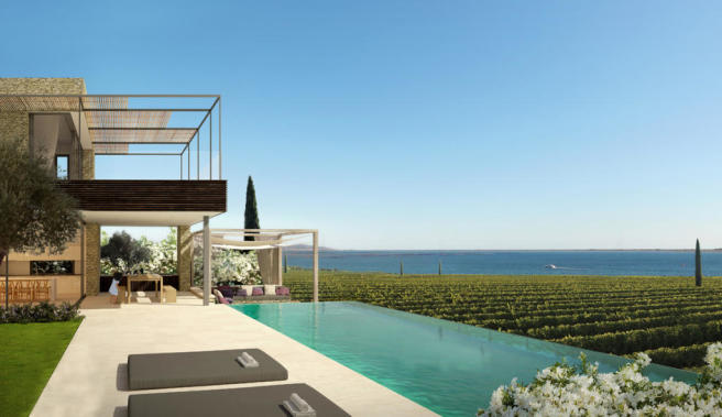Frontline premium villa with pool and terrace overlooking vineyard and lagoon