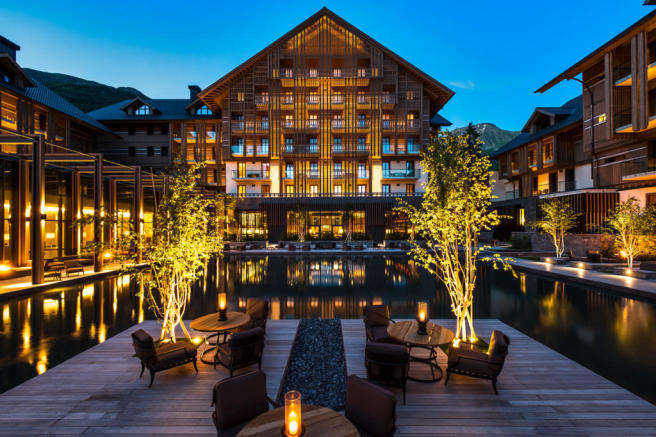 The Chedi Andermatt Hotel courtyard with water feature at dusk