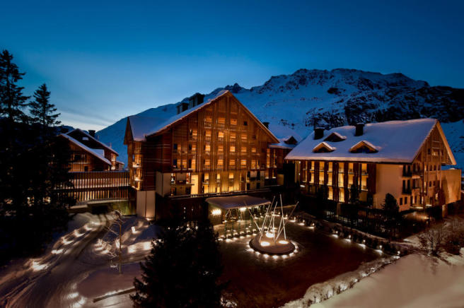 View of The Chedi Andermatt Hotel at dusk