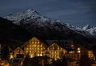 Facade night mountains Andermatt Chedi Residences