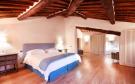 Bedroom wood floor exposed beams Tenuta Cipressino Tuscany