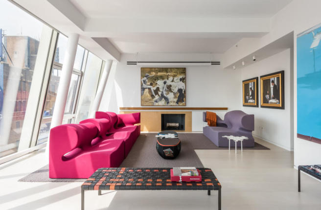 Modern living room with floor to ceiling windows at 515 West 23rd Street, Apt 12