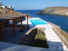 Swimming pool covered terrace sun ocean sea view Fokos Mykonos